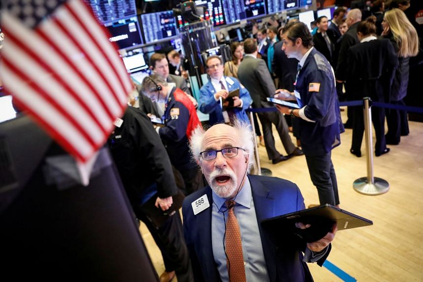Trader Peter Tuchman works on the floor at the New York Stock Exchange, Jan 21, 2020.