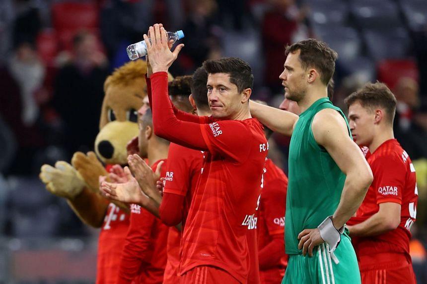 Bayern Munich's Robert Lewandowski applauds fans after a match.