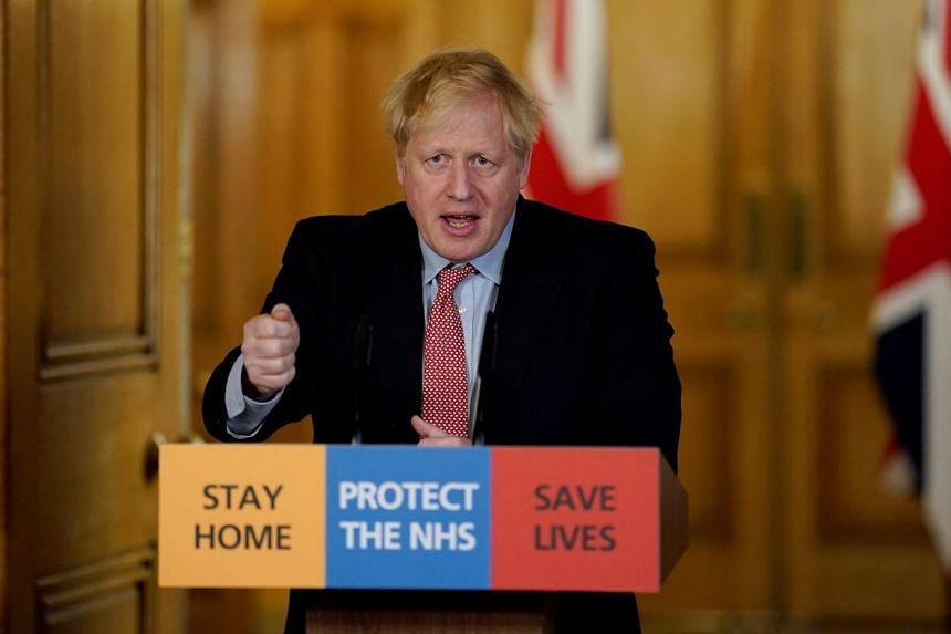 Britain's Prime Minister Boris Johnson speaks during his first remote news conference on coronavirus, March 25, 2020.