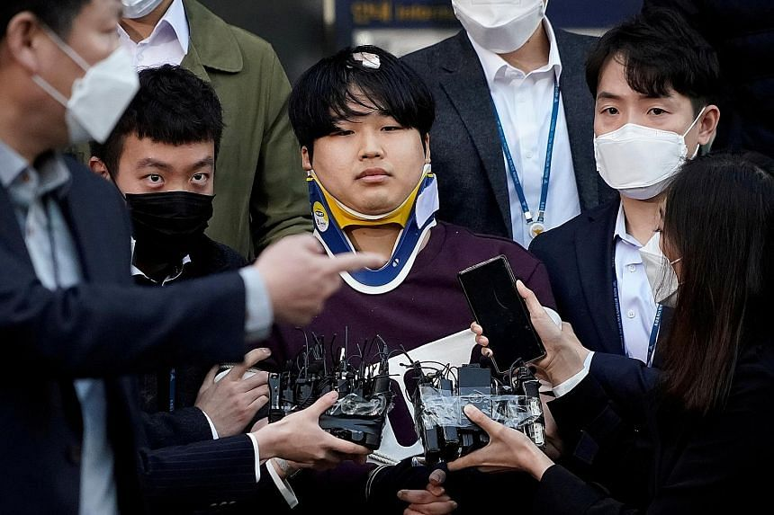 Cho Ju-bin, who was arrested last week for allegedly sexually abusing 74 women, including 16 who are underage - by luring and blackmailing them into sending him obscene images and videos of themselves that he then posted in chat rooms - walking out o
