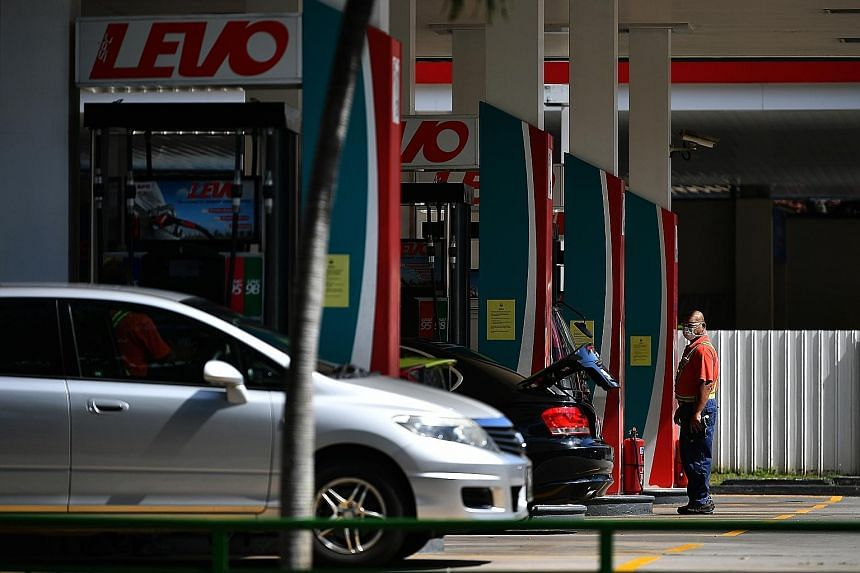 """The listed price of octane 95 petrol fell by 20 cents a litre, said Senior Parliamentary Secretary (Trade and Industry) Tan Wu Meng. """"This represents a pass-through of over three-quarters of the decrease in crude oil price."""""""