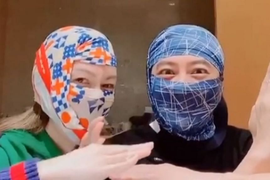 Singer Eric Suen and his wife put the briefs on their heads and adjusted them so that their hair and mouths were covered, leaving only their eyes exposed.