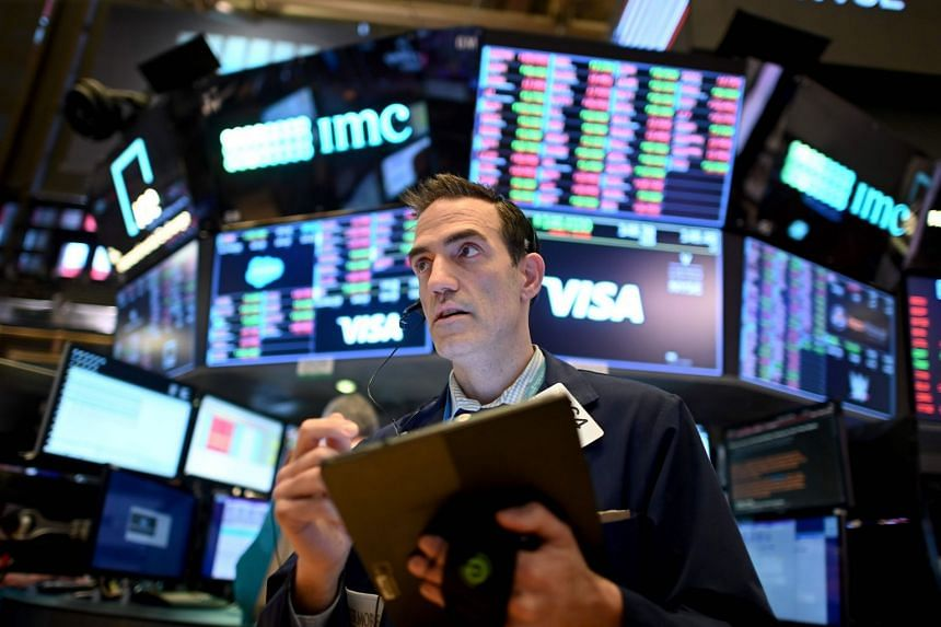 Traders work during the closing bell at the New York Stock Exchange in New York City,US, on March 18, 2020.