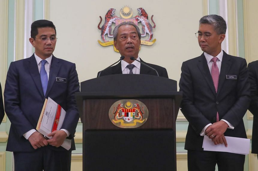 In a photo taken on March 16, 2020, Prime MInister Muhyiddin Yassin (centre) speaks during a press conference at the Prime Minister Office in Putrajaya, Malaysia.