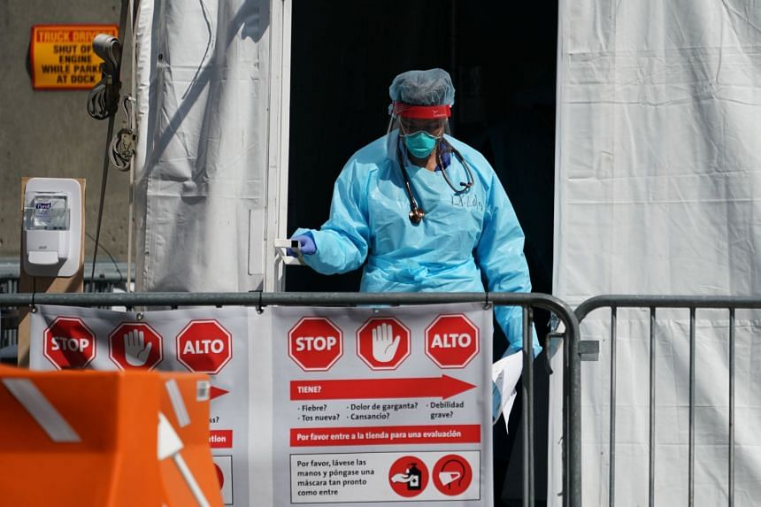A member of the medical personal leaves a Coronavirus testing tent at Brooklyn Hospital in New York, US, on March 24, 2020.