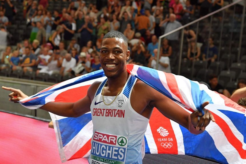 A 2018 photo shows Britain's Zharnel Hughes celebrating after winning the men's 100m final race during the European Athletics Championships in Berlin.