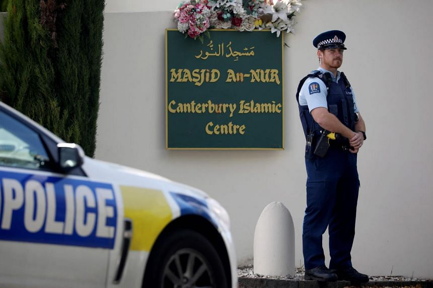 A police officer stands guard outside the Al Noor mosque in Christchurch on March 13, 2020.