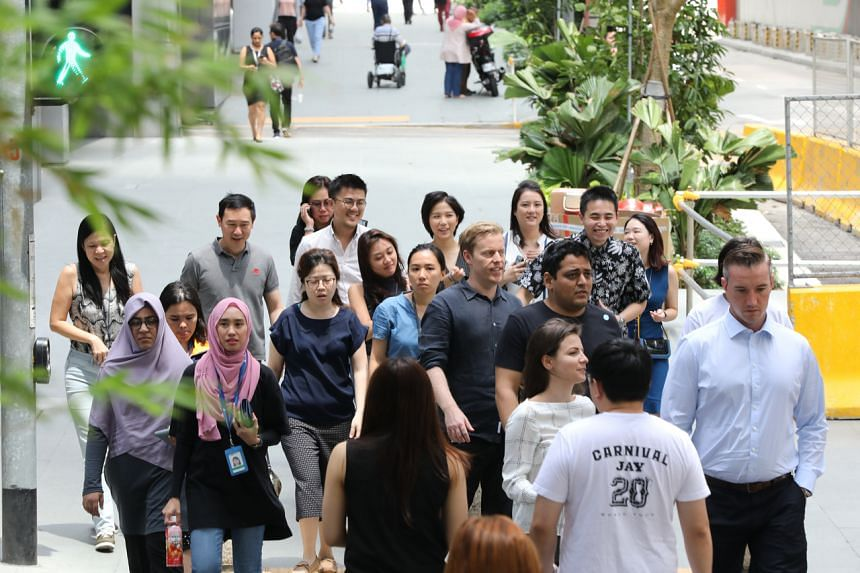 A photo from Feb 28, 2020, shows office workers at Raffles Place.