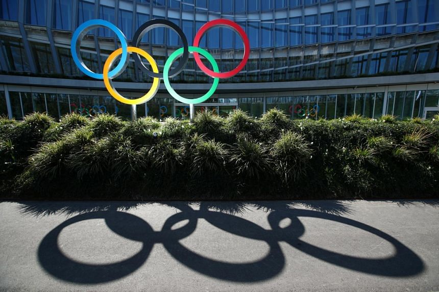 The Olympic rings are pictured in front of the International Olympic Committee headquarters in Lausanne, Switzerland, on March 24, 2020.