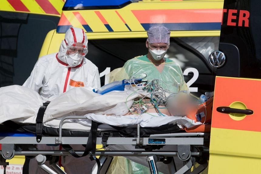 An Italian Covid-19 patient arrives at the Helios hospital in Leipzig on March 25, 2020.