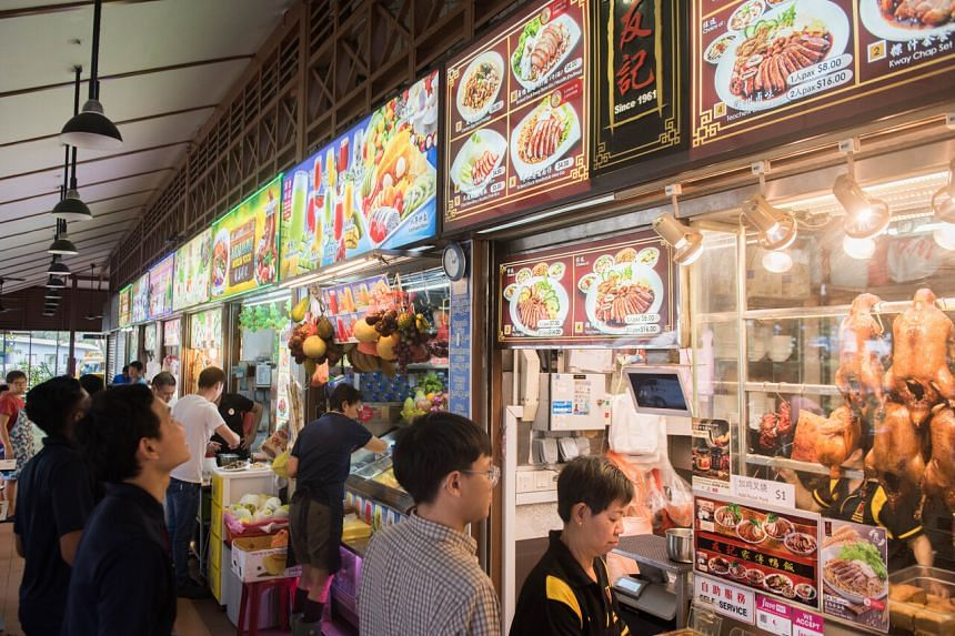 The waivers are for stallholders at hawker centres and markets managed by the National Environment Agency.