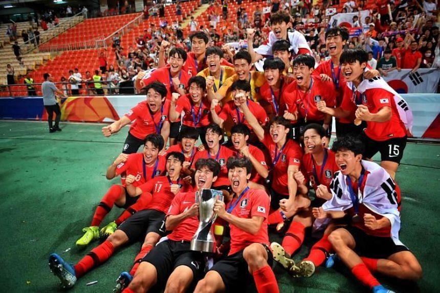 A photo taken on Jan 26, 2020 shows South Korean players celebrate their win at the AFC U-23 Championship final football match at Rajamangala Stadium in Bangkok.
