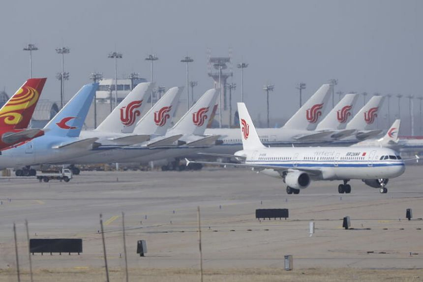Planes are seen at the international airport in Beijing on March 23, 2020.