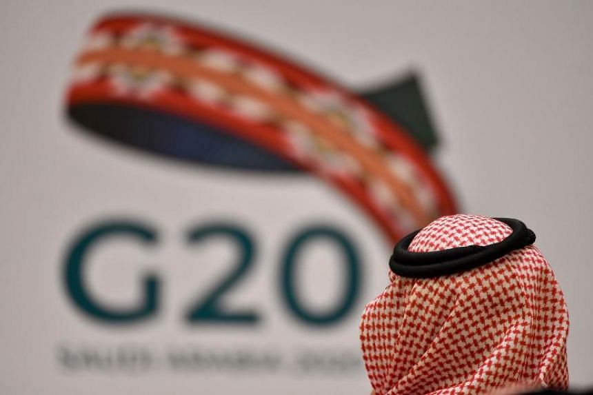 """G-20 finance ministers and central bankers agreed to develop an """"action plan"""" to respond to the outbreak, which the International Monetary Fund expects will trigger a global recession."""