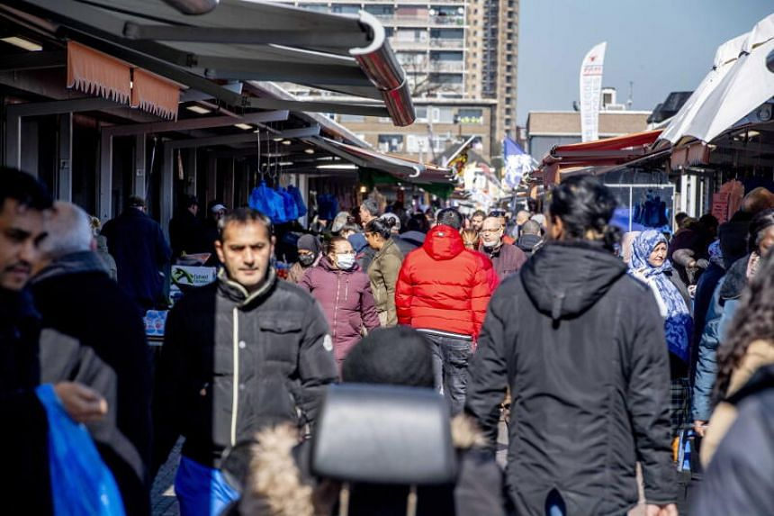 Visitors at the Hague Market in the Netherlands on March 25, 2020.
