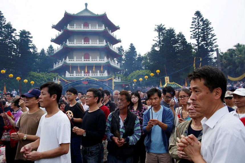 A photo taken on April 4, 2016 shows thosuands of people attend an annual worship ceremony on Qingming Festival in Taoyuan, Taiwan.