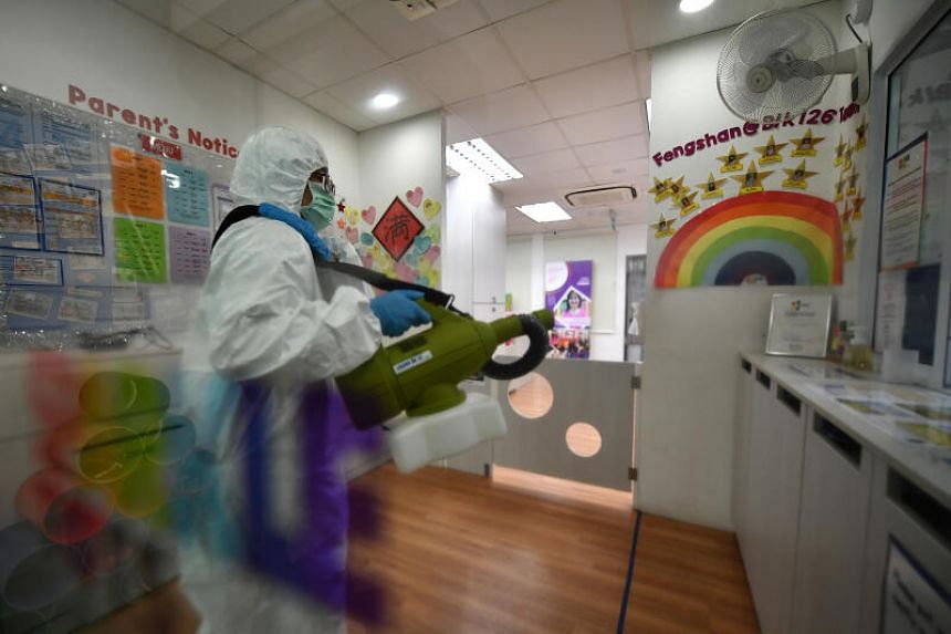 A professional cleaner disinfects the PCF Sparkletots Fengshan premises on March 24, 2020.