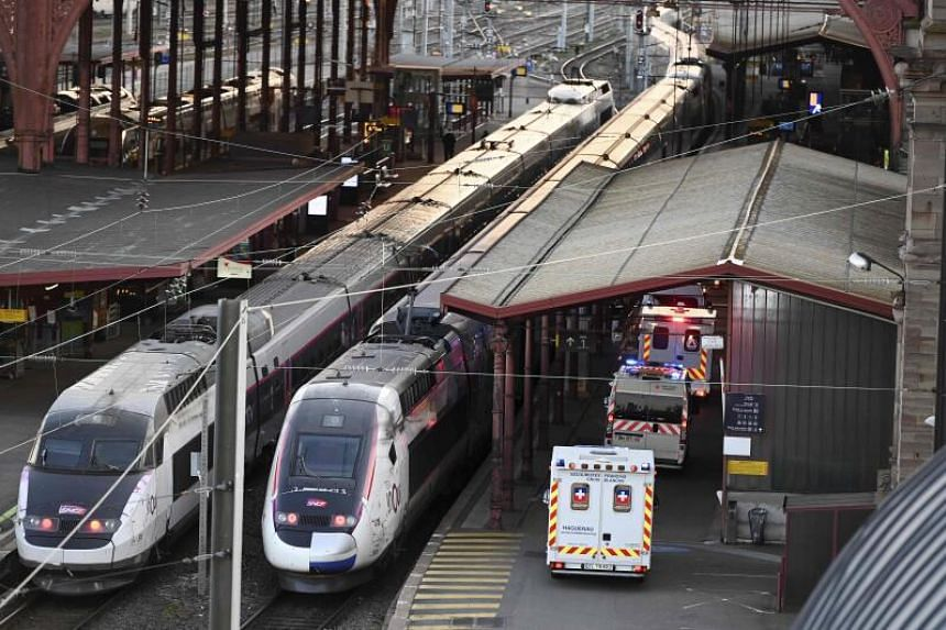 Ambulances stand by to load patients affected with coronavirus aboard a medicalised high-speed train in Strasbourg, France, on March 26, 2020.