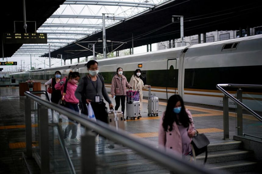 Passengers wearing face masks at a railway station in Xianning, Hubei, on March 25, 2020.