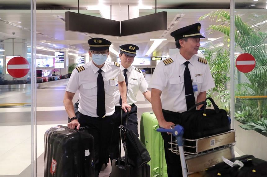 Singapore Airlines flight crew arriving at Changi Airport Terminal 2 from London on SQ317, March 24, 2020.