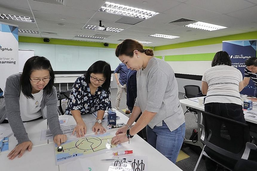 A coding class at the NTUC LearningHub in Bras Basah. Singaporeans can check which courses are eligible for the early use of their SkillsFuture Credit top-up on the MySkillsFuture portal. ST PHOTO: GAVIN FOO