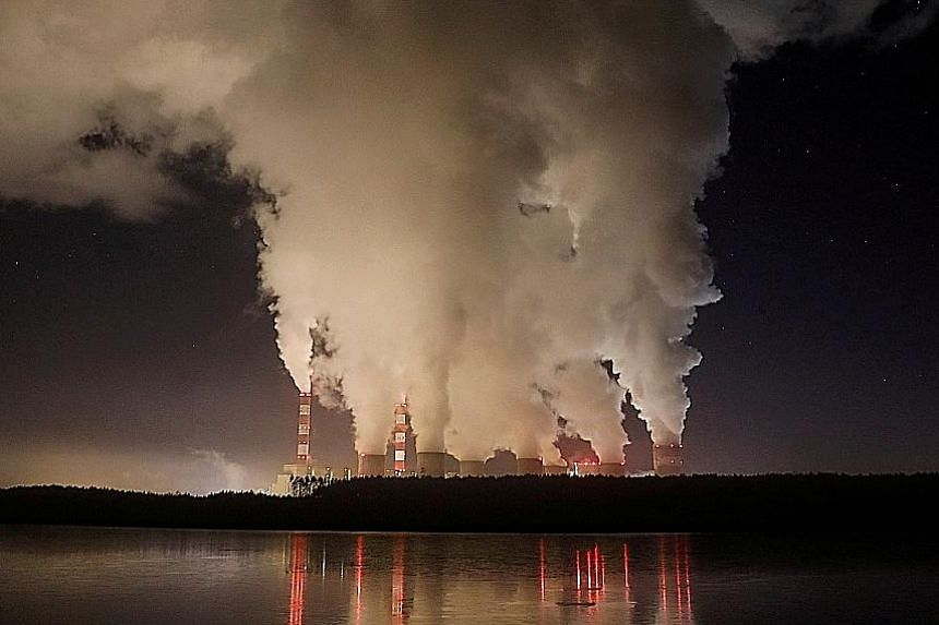 Smoke and steam billowing from a power station in Poland in 2018. New coal plants, mainly in China, have led to additional global capacity but ultimately, less power generation because of reduced usage, a study says.