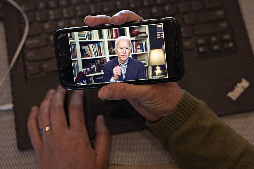 Mr Joe Biden during a virtual press briefing from his home in Wilmington, Delaware, on Wednesday. Like his rival Bernie Sanders, Mr Biden has been forced off the physical campaign trail because of the coronavirus outbreak and has to find new ways of