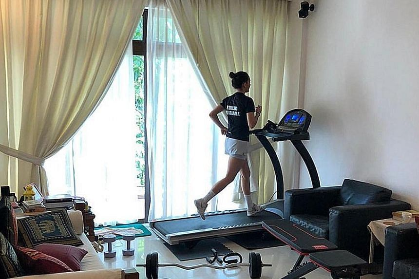 Amita Berthier using the treadmill to keep her fitness level up while serving a stay-home notice since Wednesday. PHOTO COURTESY OF AMITA BERTHIER