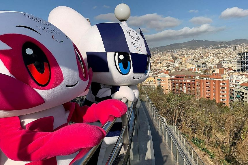Tokyo 2020 mascots Someity (Paralympics) and Miraitowa (Olympics) on their Make The Beat tour in Barcelona this month. The Games were deferred on Tuesday. PHOTO: REUTERS