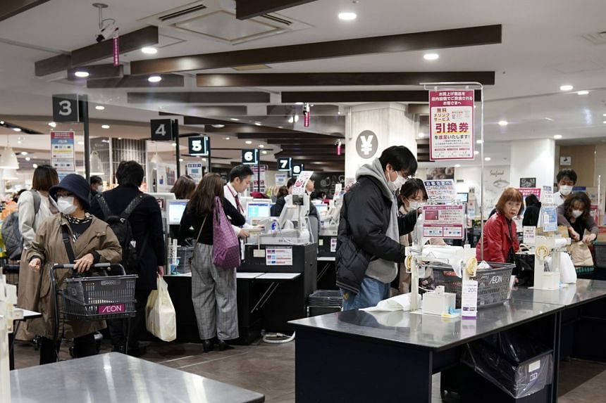 People line up at a supermarket in Tokyo, Japan, on March 26, 2020.
