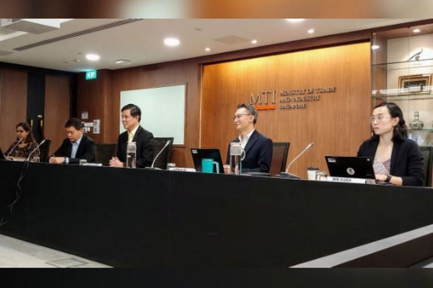 Minister for Trade and Industry Chan Chun Sing (centre) with officials from the Ministry of Trade and Industry - (from left) Asean division director Alpana Roy, Trade Deputy Secretary Luke Goh, North-east Asia division senior director of  Adrian Ng a