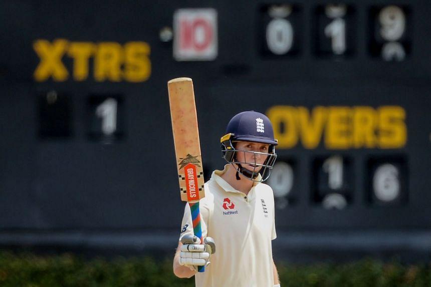 England's Zak Crawley raises his bat after scoring a half-century (50 runs) during a practice match against Sri Lanka on March 12, 2020.
