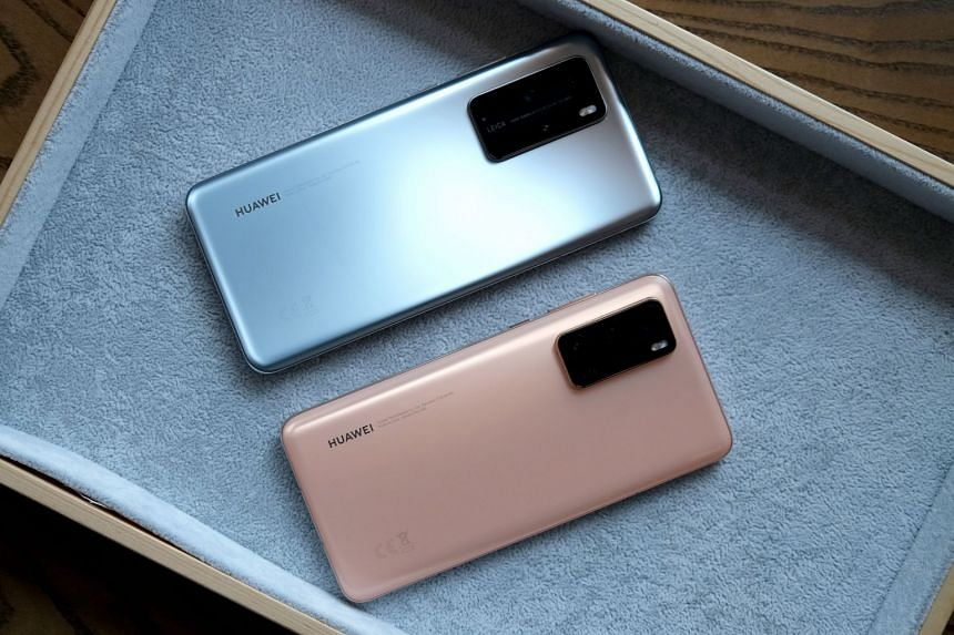 The new Huawei P40 Pro (top) and Huawei P40 are launched via a livestream as a result of the Covid-19 outbreak. The P40 Pro smartphone offers up to 5x optical zoom and up to 50x digital zoom.