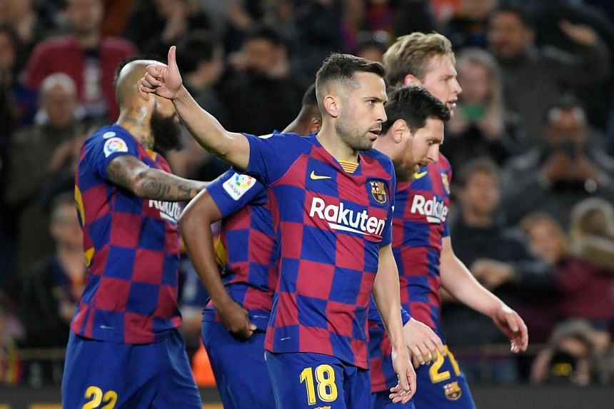 Barcelona's Spanish defender Jordi Alba celebrates a goal with team mates.