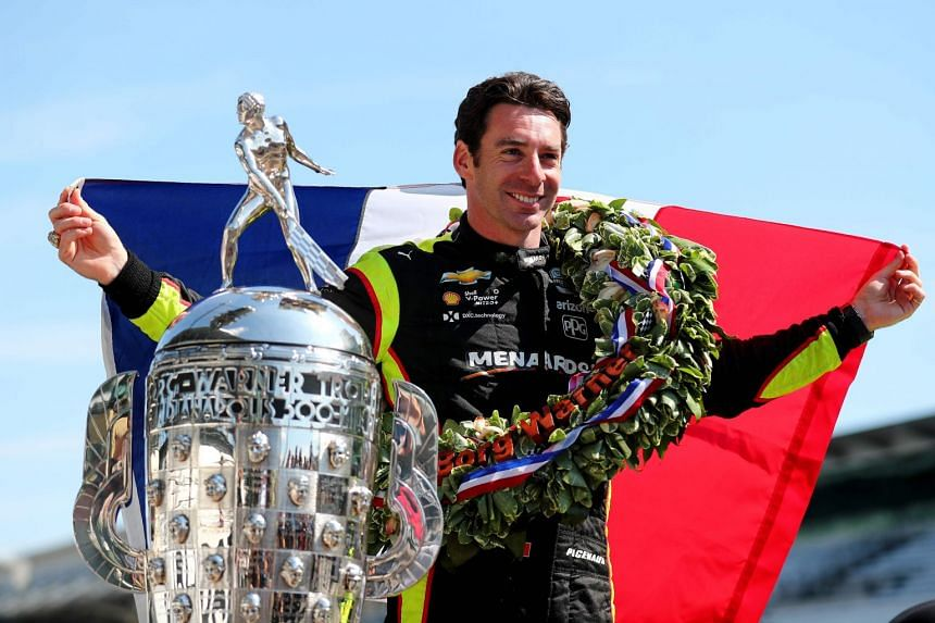 A May 2019 photo shows Indy 500 winner Simon Pagenaud of France posing with the trophy.