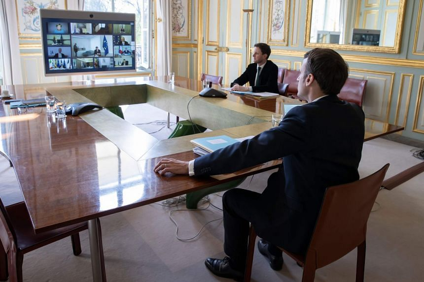 Macron (right) attends a video conference call with members of the European Council, March 26, 2020.