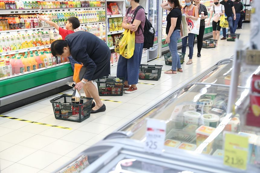 Shoppers at the FairPrice supermarket in City Square Mall on March 27, 2020.