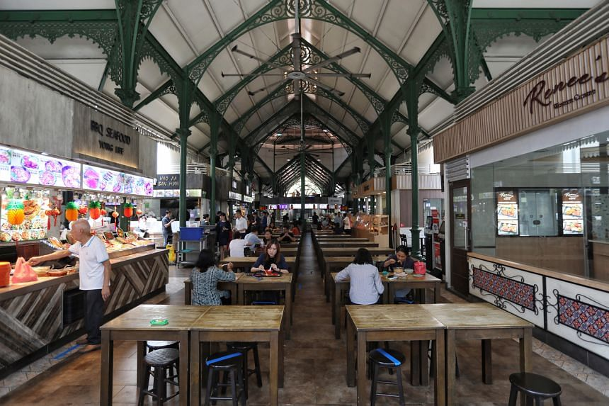 Patrons at Lau Pa Sat on March 27, 2020.