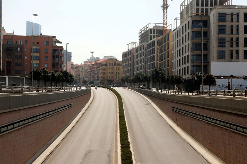 A photo taken on March 26, 2020, shows an empty highway in Beirut, as Lebanon is set to extend a countrywide lockdown by two weeks to combat the spread of coronavirus.
