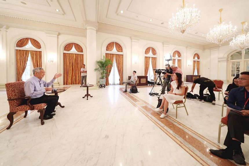 Prime Minister Lee Hsien Loong speaking to reporters at the Istana on March 27, 2020.