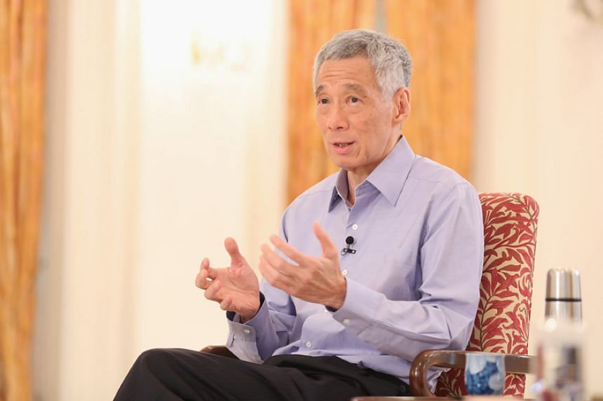 """Prime Minister Lee Hsien Loong said the Government will do """"whatever it takes"""" to stabilise the economy, preserve jobs and help companies stay afloat."""