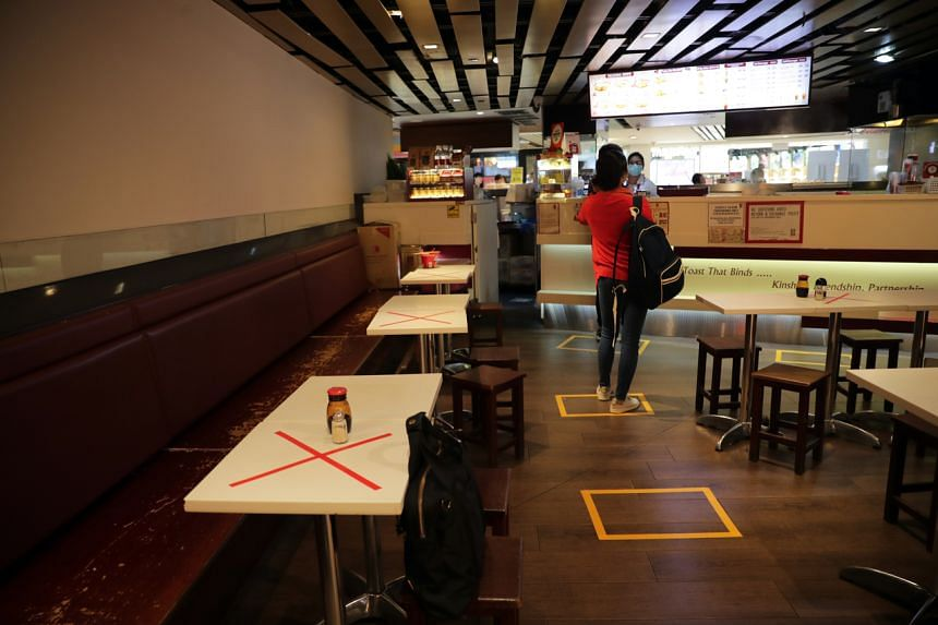 Safe distancing measures at a restaurant in Raffles City Shopping Centre on March 27, 2020.