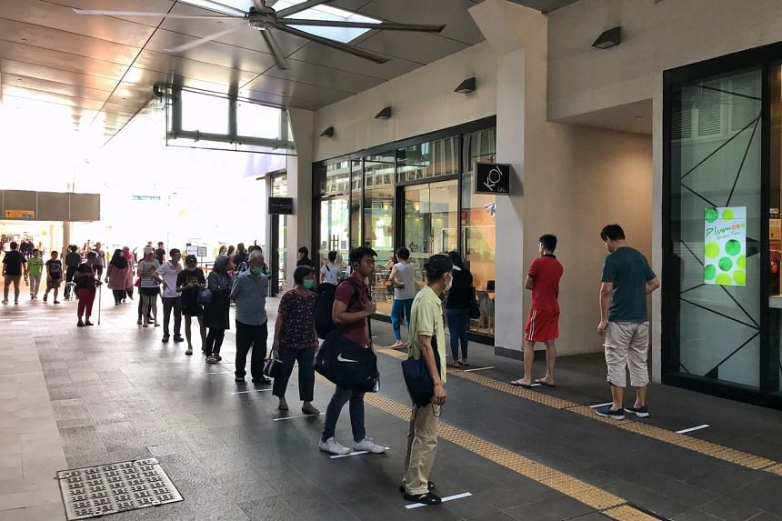 People queueing to enter White Sands Shopping Mall in Pasir Ris on March 27, 2020.