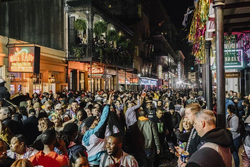 Mardi Gras revelers on Bourbon Street in New Orleans, US, on Feb 22, 2020.