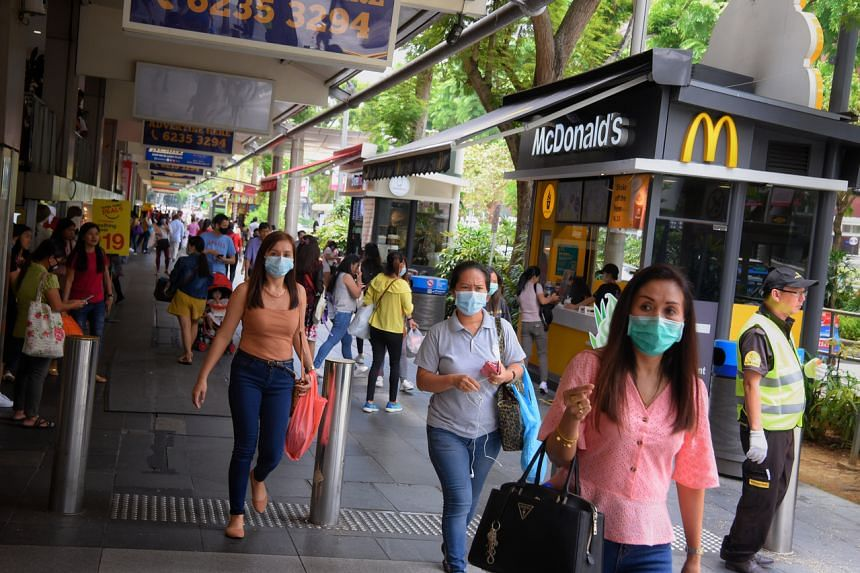 MOM said it will step up inspections at Lucky Plaza, City Plaza and Peninsula Plaza to disperse large groups of FDWs.