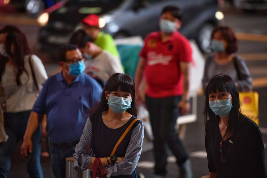 People wearing masks outside The Heeren at Orchard Road on March 5, 2020.