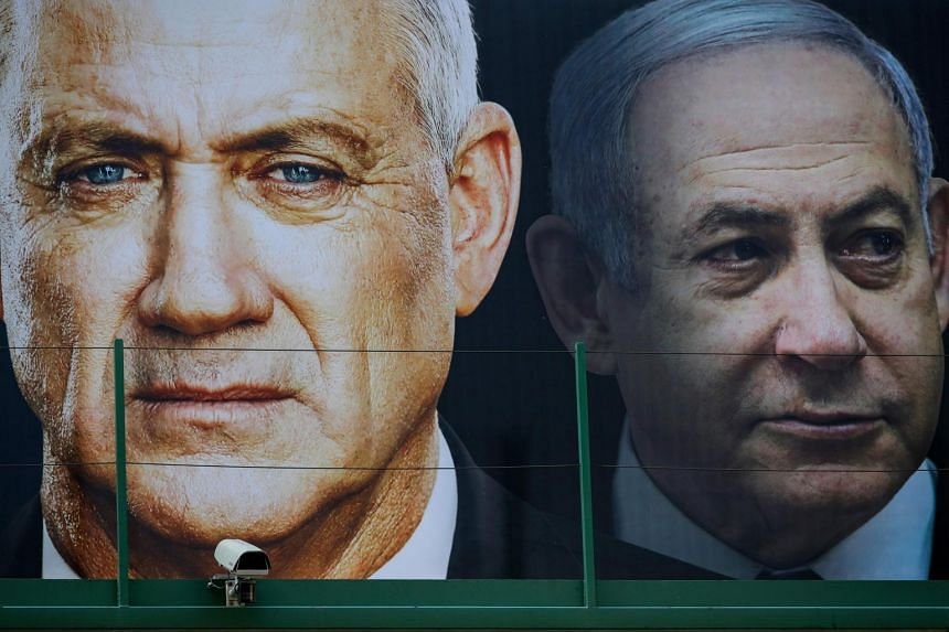An election banner for the Israeli Blue and White political alliance with the face of its leader retired army general Benny Gantz (left) and Prime Minister Benjamin Netanyahu, in Ramat Gan, Israel, on Feb 17, 2020.