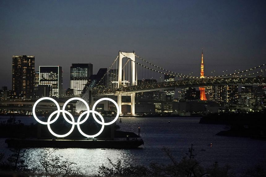 A giant Olympic rings monument is seen at Odaiba Marine Park in Tokyo, Japan, on March 25, 2020.