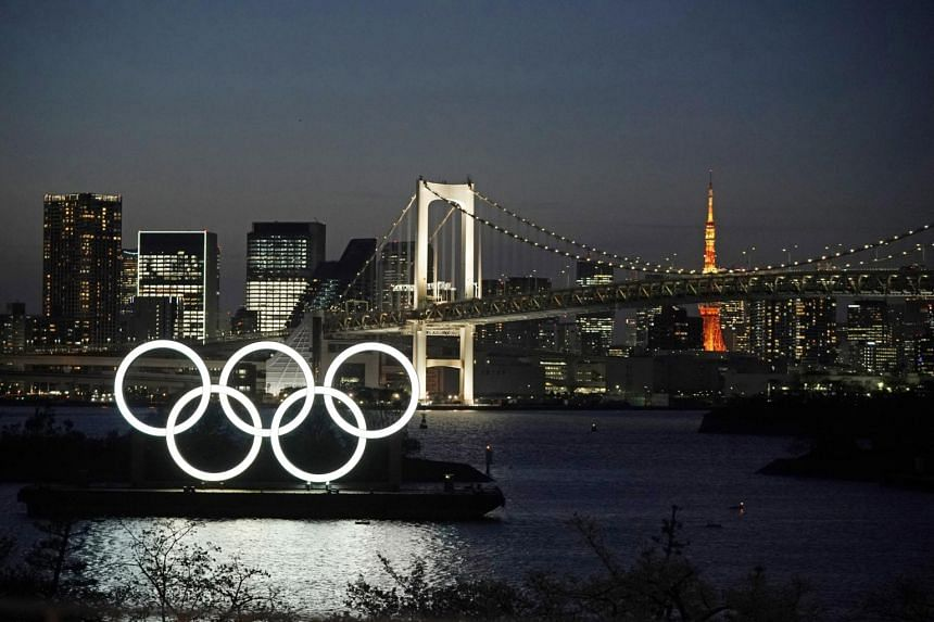 A giant Olympic rings monument is seen at dusk at Odaiba Marine Park in Tokyo, Japan, on March 25, 2020.