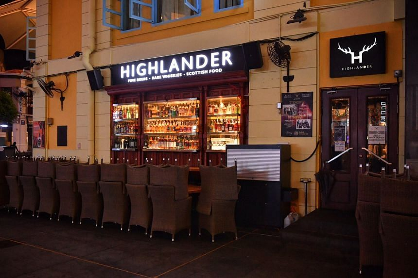 Chairs are neatly stacked up outside Highlander at Clark Quay on March 27, 2020.